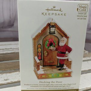 Hallmark decking the door 2011 santa xmas ornament